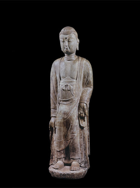 View Limestone figure of a standing Buddha
