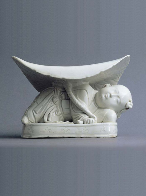 Porcelain Pillow in the shape of a Reclining Boy, Ding Ware