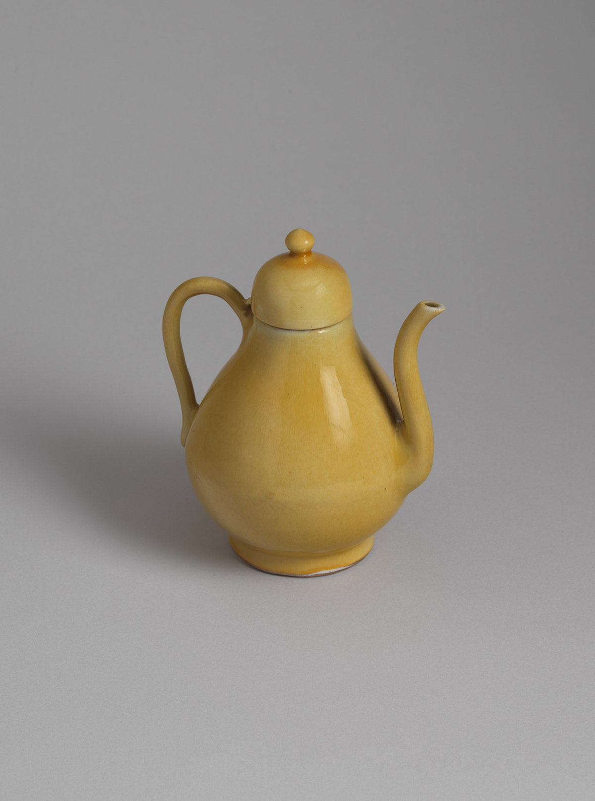 Yellow-glazed porcelain ewer and cover