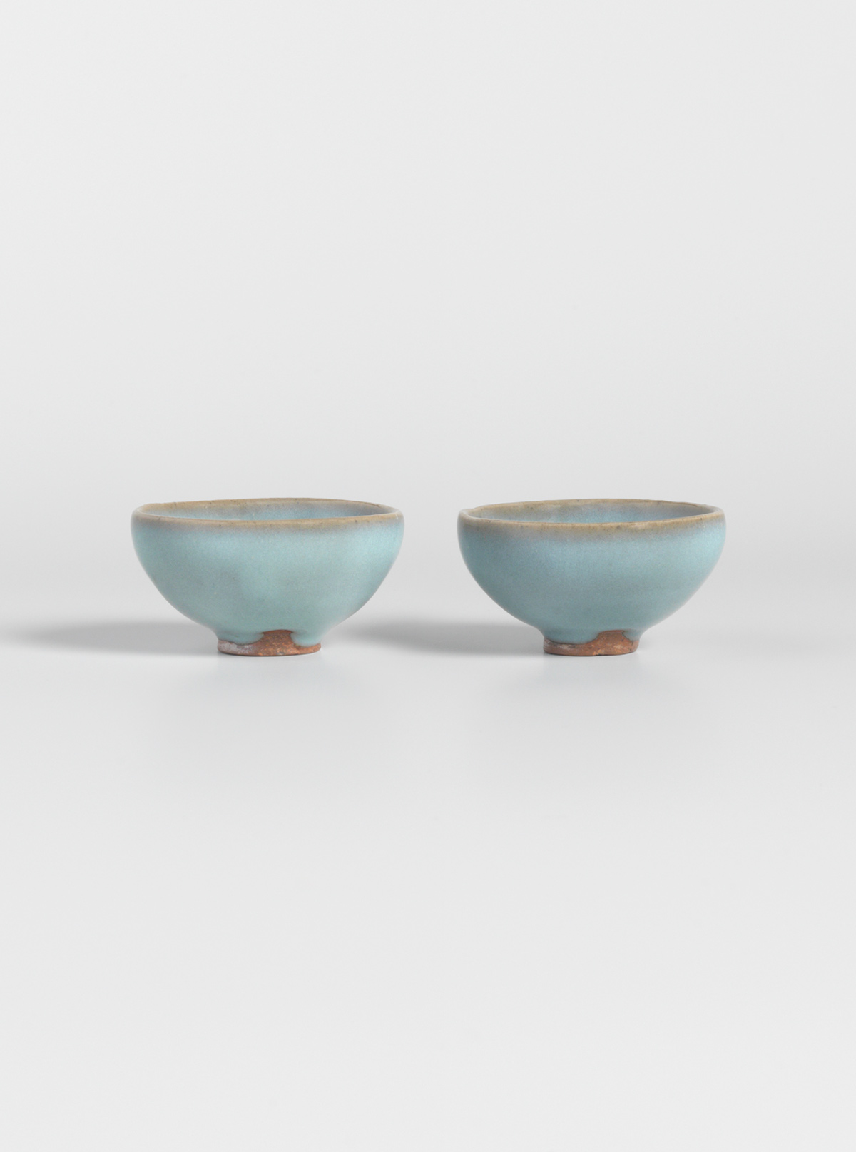 Pair of small glazed stoneware bowls