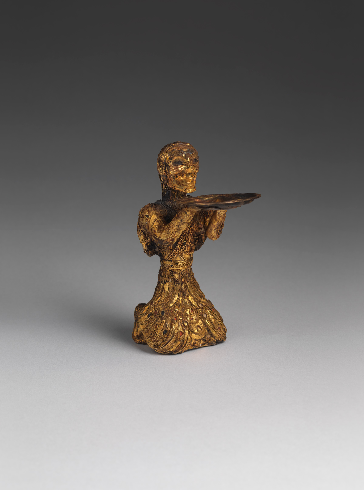 Gold kneeling figure
