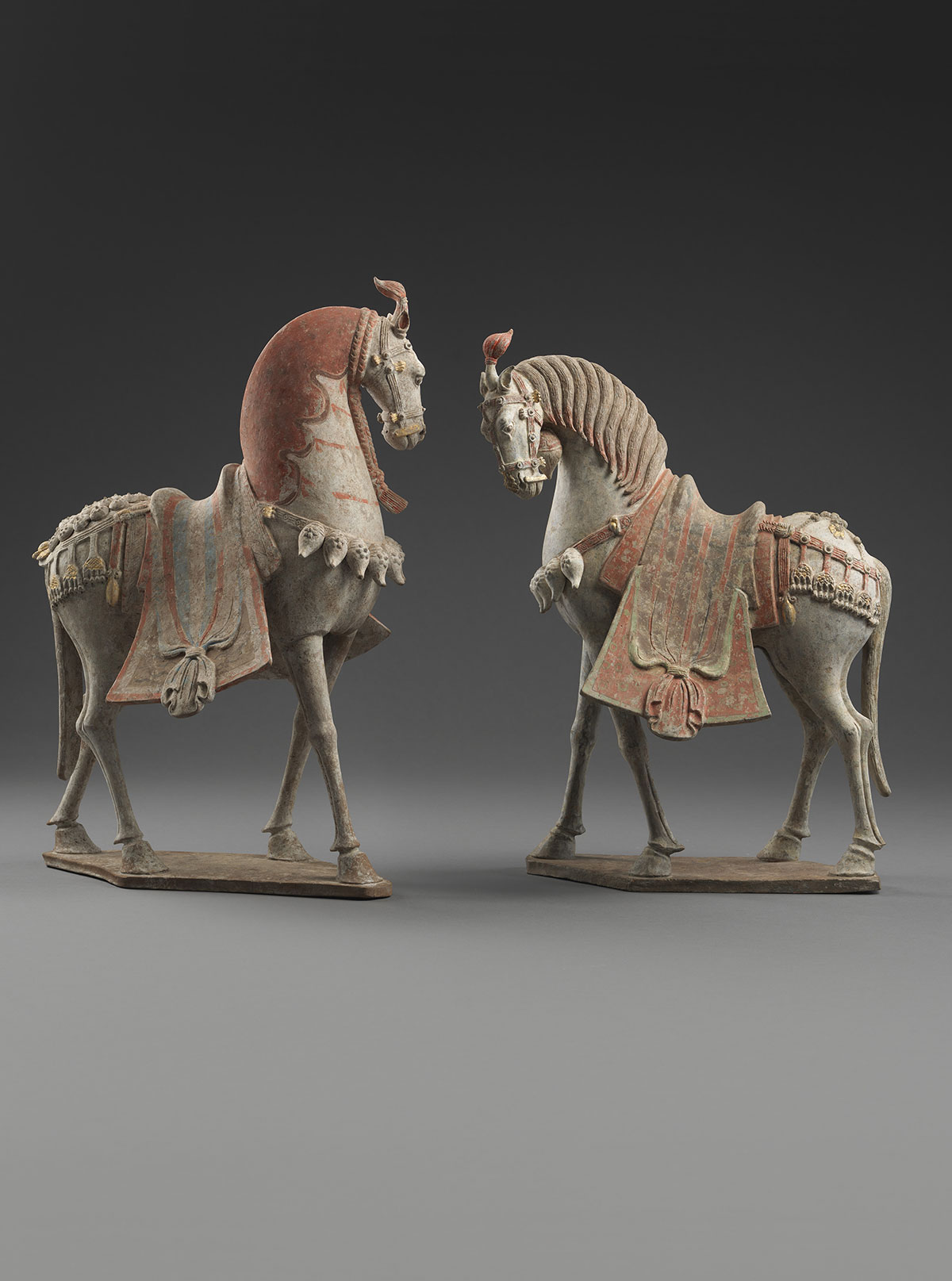 Two Painted Earthenware Caparisoned Horses