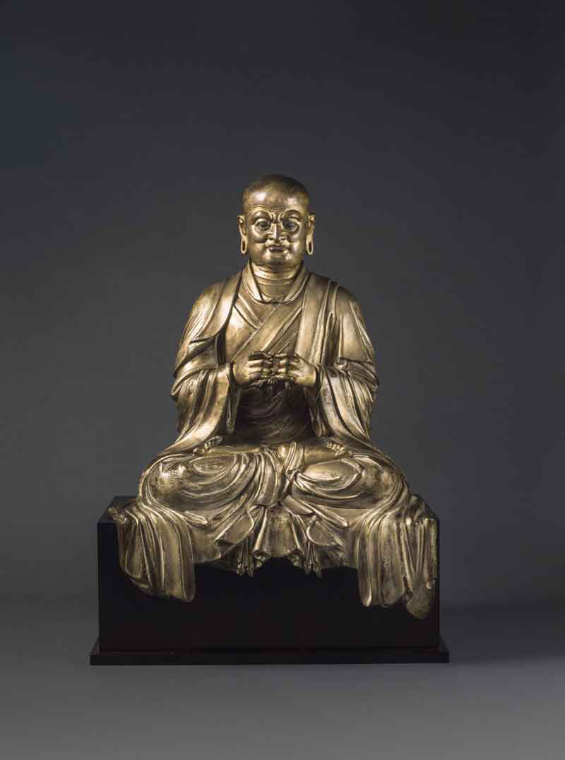Gilt lacquered bronze figure of a Luohan