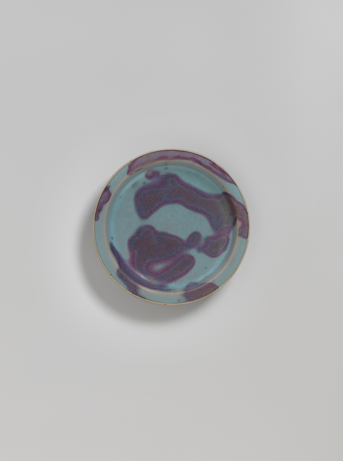 Blue-glazed splashed stoneware dish