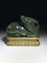 View Imperial spinach-green jade water buffalo, on gilt-bronze stand
